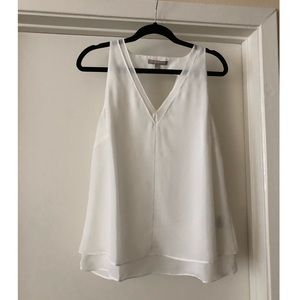 Flowy white tank with neck detailing